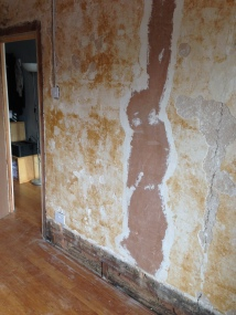 Skirting boards come off. Back to the old brick!