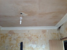 Ceiling paper gone reveals very good plasterwork - our workman is happy