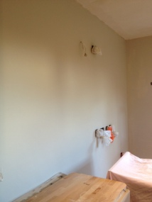 Second coat on the wall where the high units are going. Looking better...