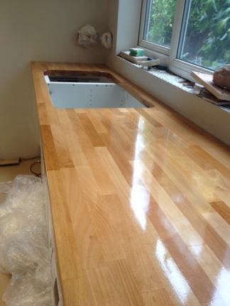 Close up! Oiling of the work surface continues...