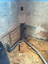 Pipes going down for bath and shower